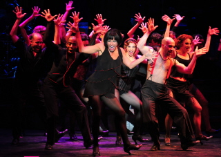 Rachelle Rak and the cast of Chicago